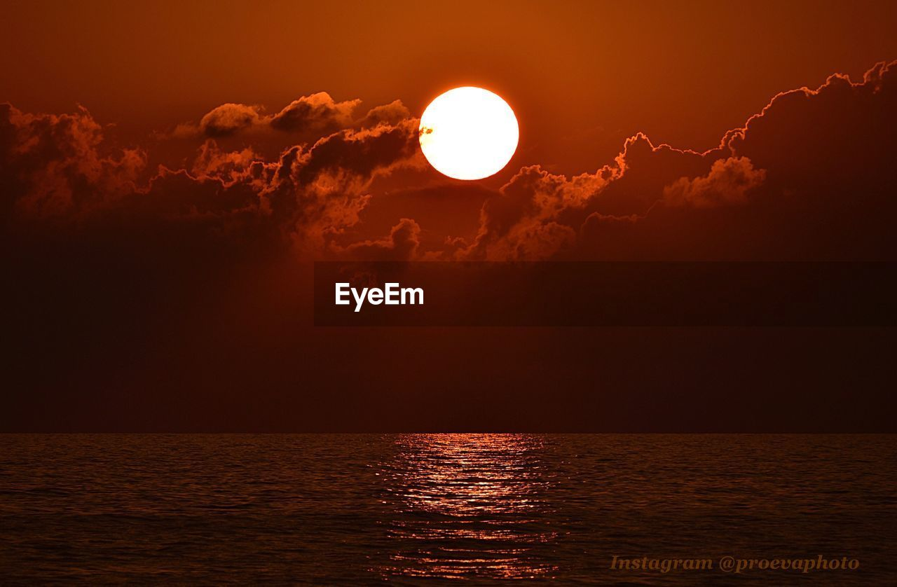 sky, scenics - nature, beauty in nature, water, sunset, sea, tranquil scene, cloud - sky, sun, tranquility, waterfront, idyllic, nature, orange color, horizon over water, horizon, no people, astronomy, circle, outdoors, eclipse, planetary moon