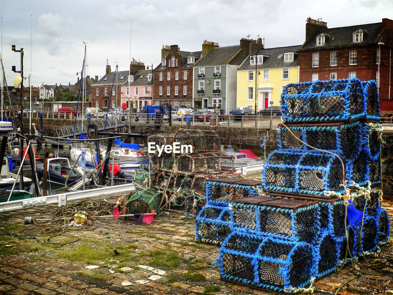 Stack Of Crab Pots Against Built Structures
