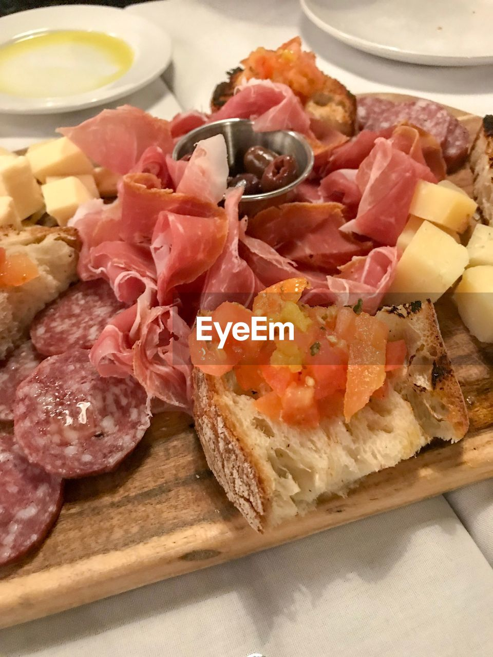 food and drink, meat, food, ready-to-eat, indoors, still life, freshness, serving size, ham, close-up, no people, plate, slice, healthy eating, chopped, pork, prosciutto