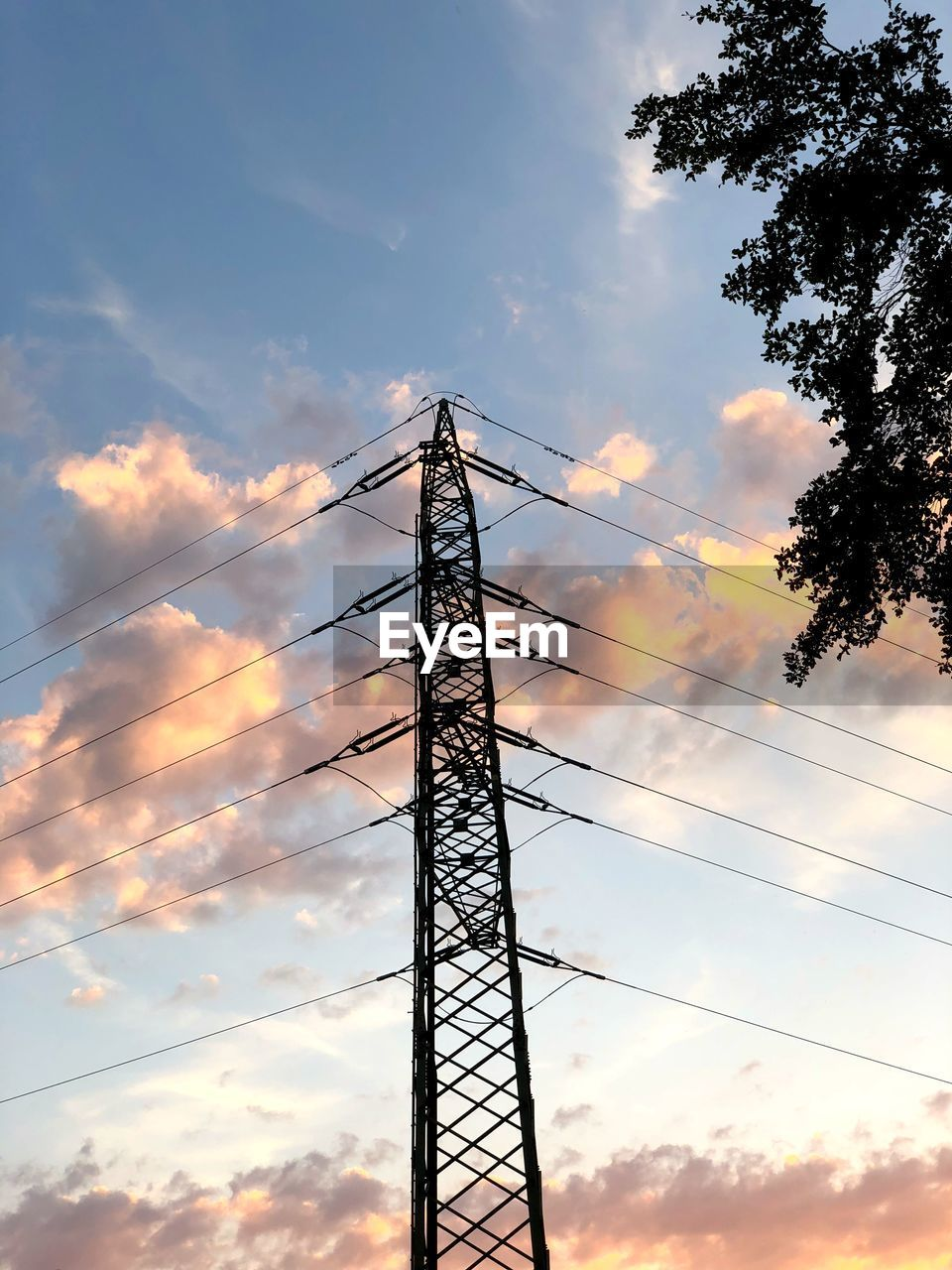 cloud - sky, sky, technology, electricity, sunset, low angle view, electricity pylon, power supply, nature, power line, no people, connection, silhouette, cable, fuel and power generation, outdoors, tree, architecture, metal, built structure, electrical equipment