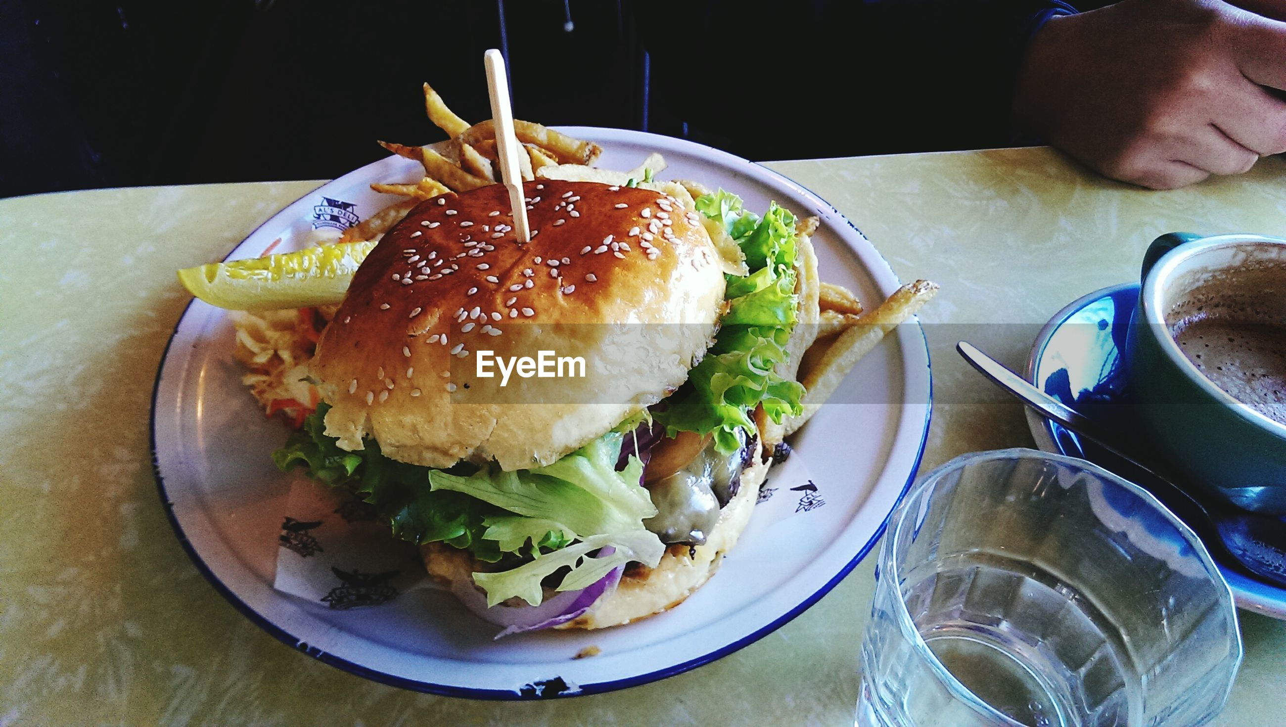 High angle view of burger served in plate on table