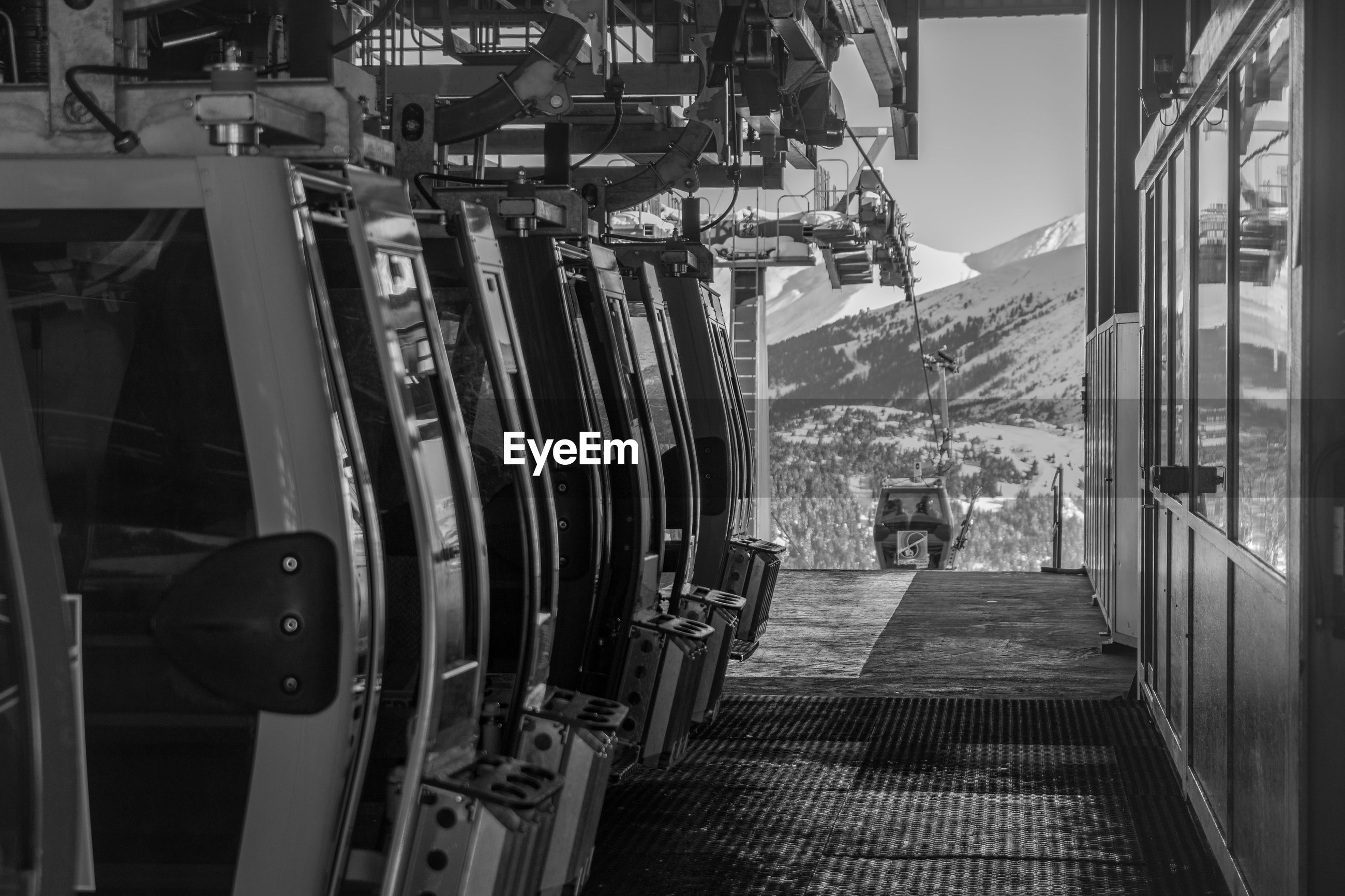 Ski lifts against sky during winter