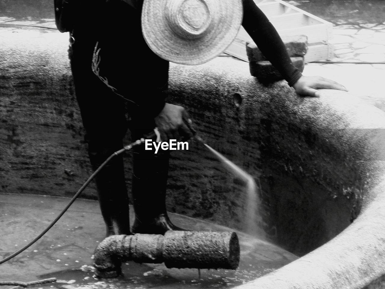 MAN WORKING ON WATER