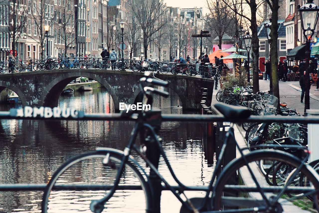 architecture, transportation, building exterior, built structure, city, mode of transportation, water, bicycle, land vehicle, bridge, bridge - man made structure, canal, connection, incidental people, day, street, building, nature, outdoors