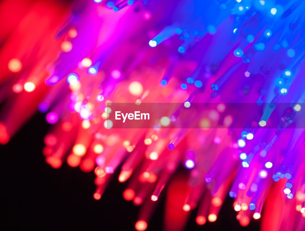 fiber optic, technology, illuminated, abstract, lighting equipment, glowing, vibrant color, multi colored, internet, close-up, no people, backgrounds, electrical equipment, red, computer network, defocused, black background, computer equipment, fiber, science, indoors, eyesight, night