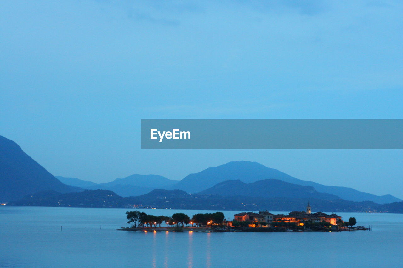 Scenic view of lake maggiore against sky at dusk
