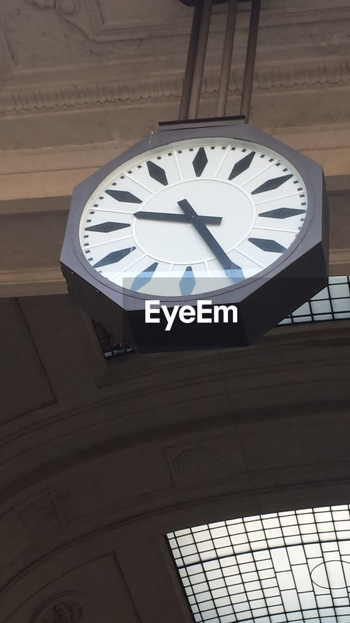 clock, low angle view, time, no people, clock face, indoors, instrument of time, circle, minute hand, geometric shape, built structure, accuracy, roman numeral, shape, roman, architecture, ceiling, day, number, wall - building feature, wall clock