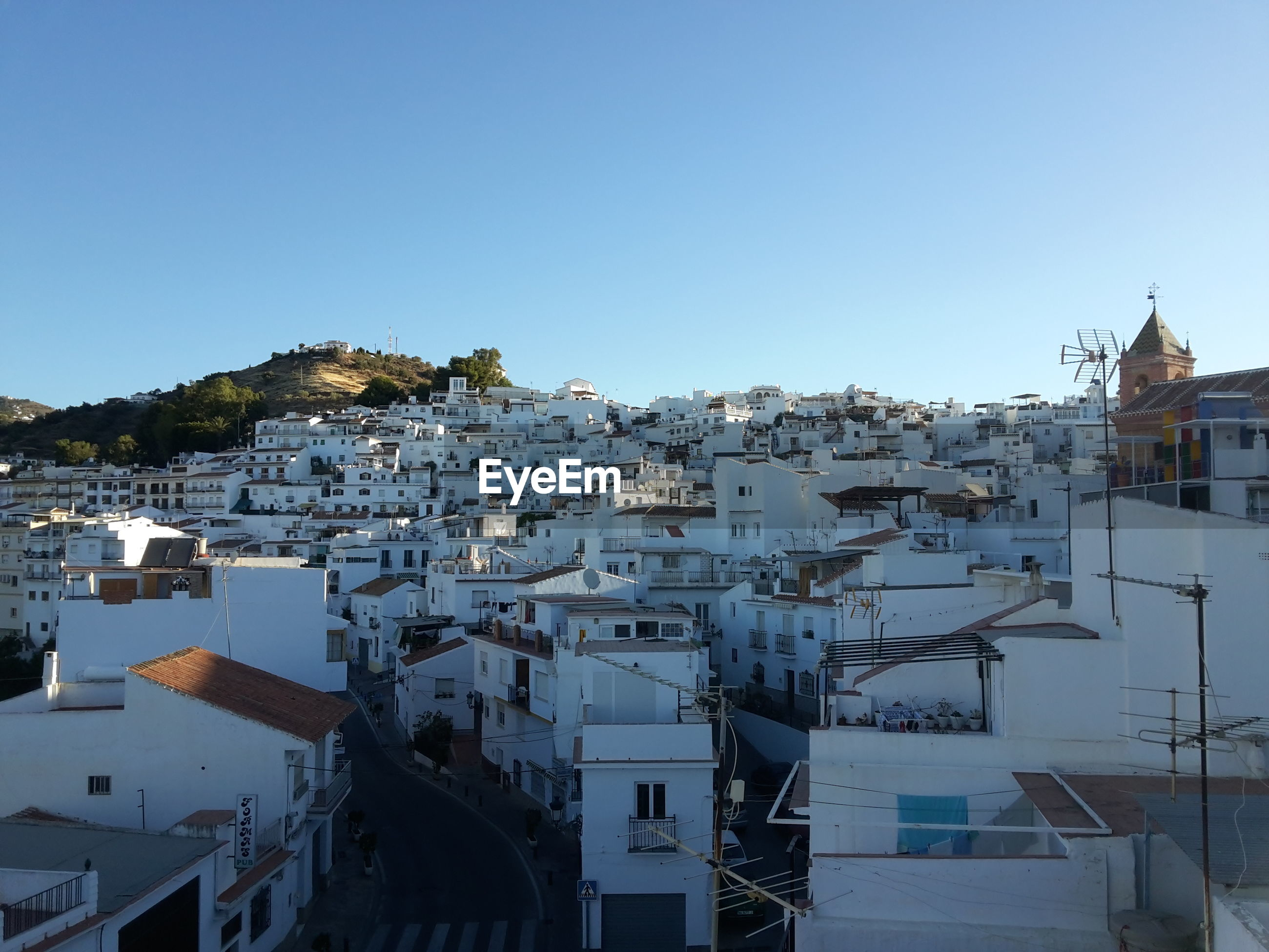 HIGH ANGLE VIEW OF HOUSES AGAINST CLEAR BLUE SKY