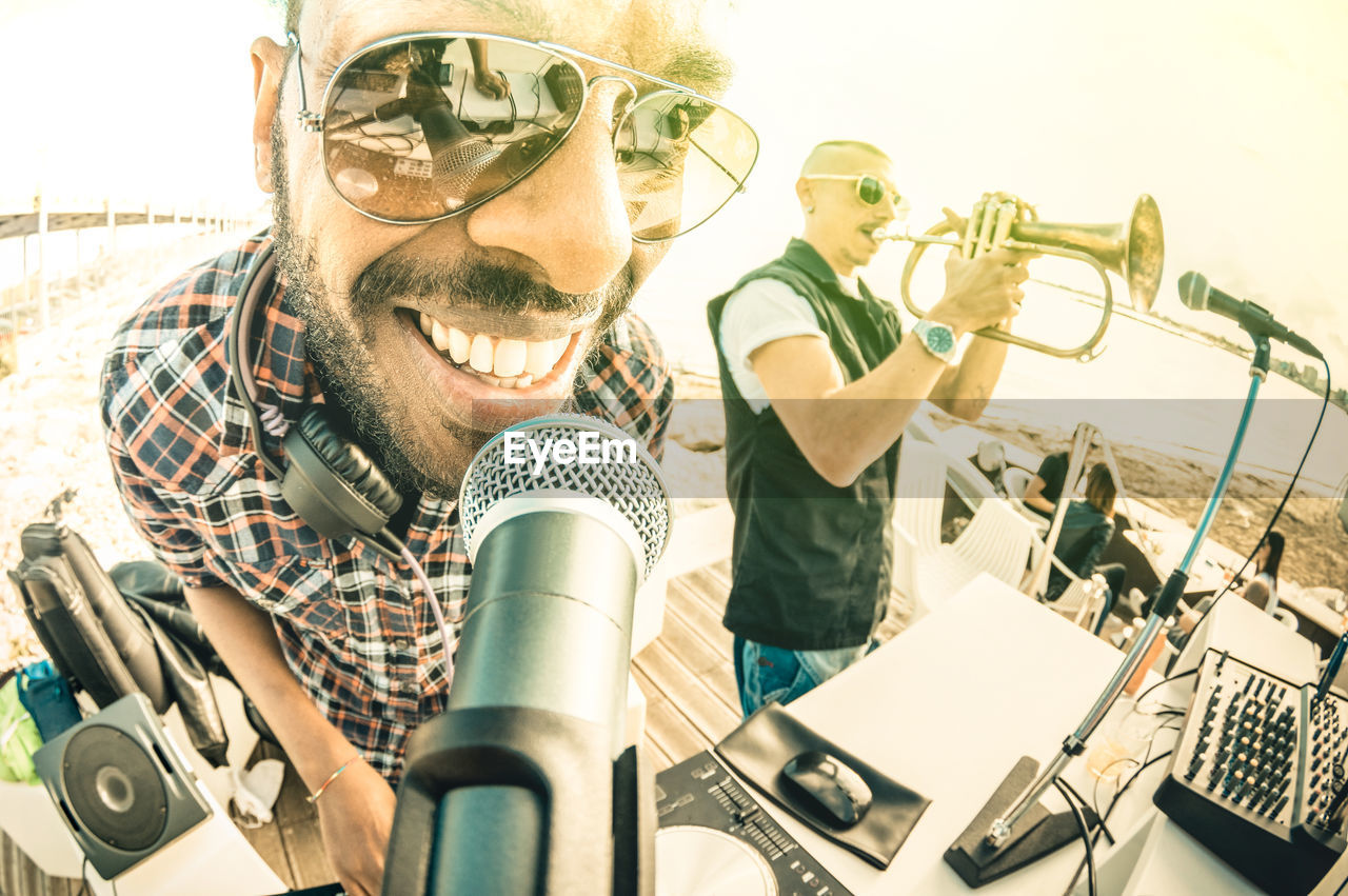 Musicians Performing At Beach
