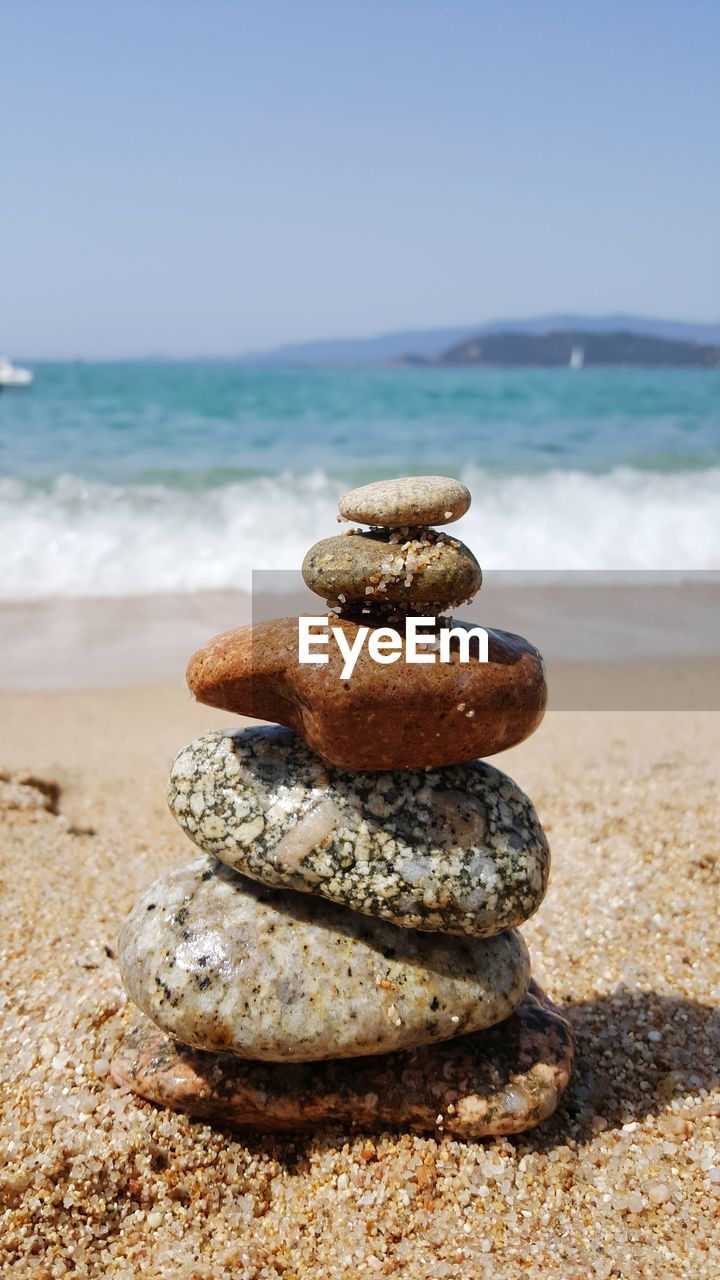 beach, land, sea, water, stack, sand, horizon over water, sky, nature, balance, focus on foreground, stone - object, no people, beauty in nature, tranquility, day, horizon, scenics - nature, zen-like, pebble, outdoors