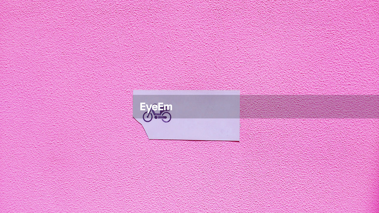 Sign On Pink Wall