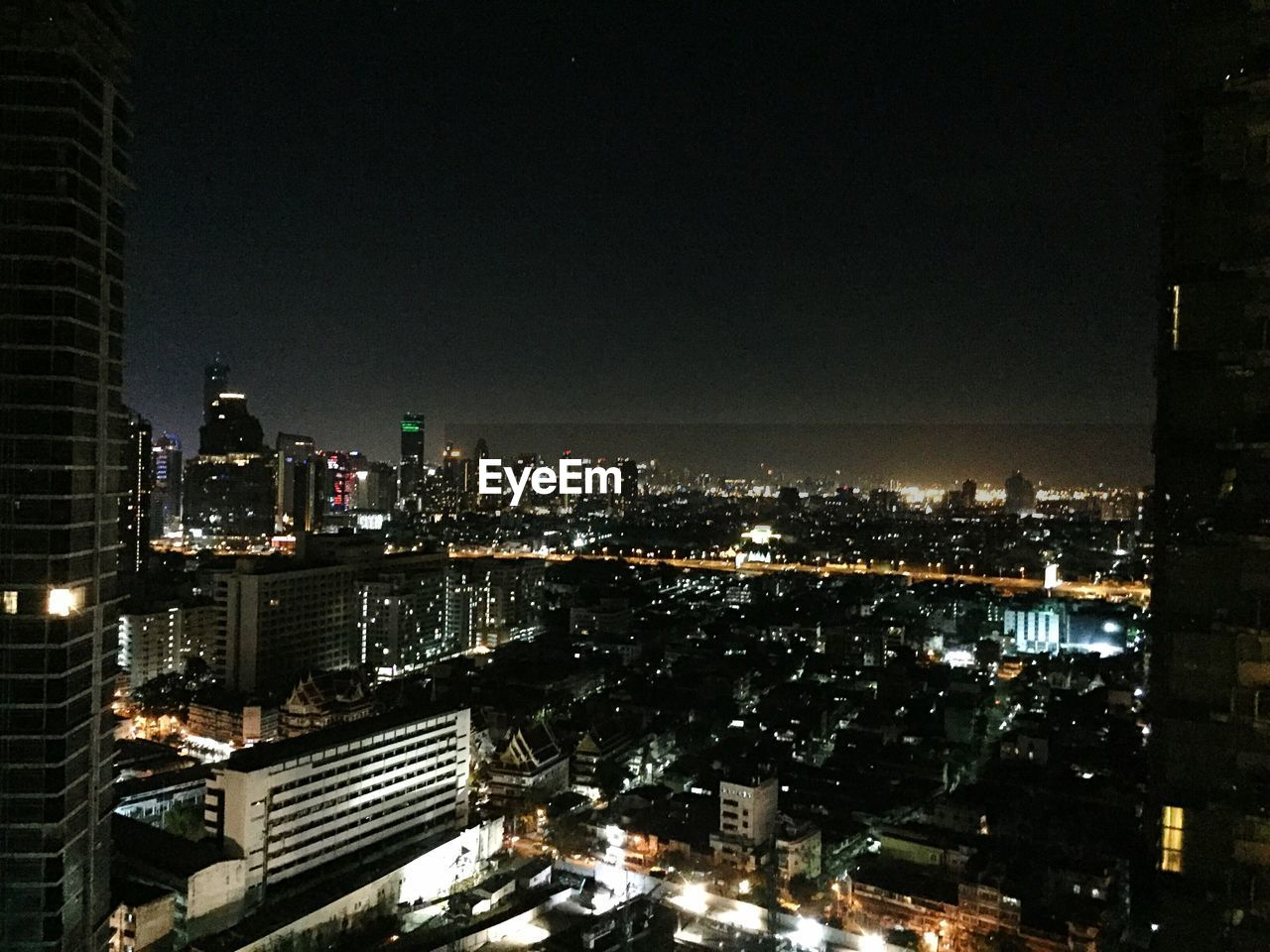 illuminated, architecture, building exterior, cityscape, city, night, skyscraper, built structure, modern, high angle view, no people, city life, travel destinations, outdoors, urban skyline, growth, sky
