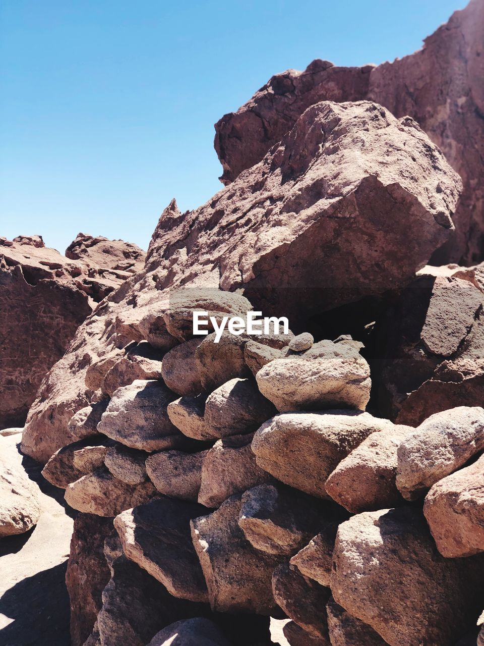 rock, sky, solid, rock - object, nature, clear sky, mountain, no people, day, beauty in nature, tranquility, tranquil scene, sunlight, rock formation, scenics - nature, physical geography, stack, geology, outdoors, non-urban scene, eroded, mountain peak, formation, arid climate