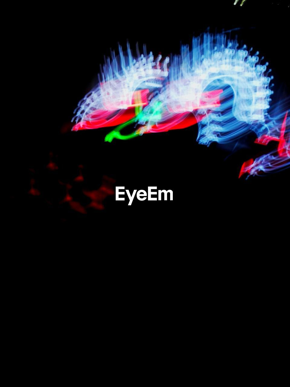 multi colored, black background, illuminated, motion, night, studio shot, no people, close-up, outdoors