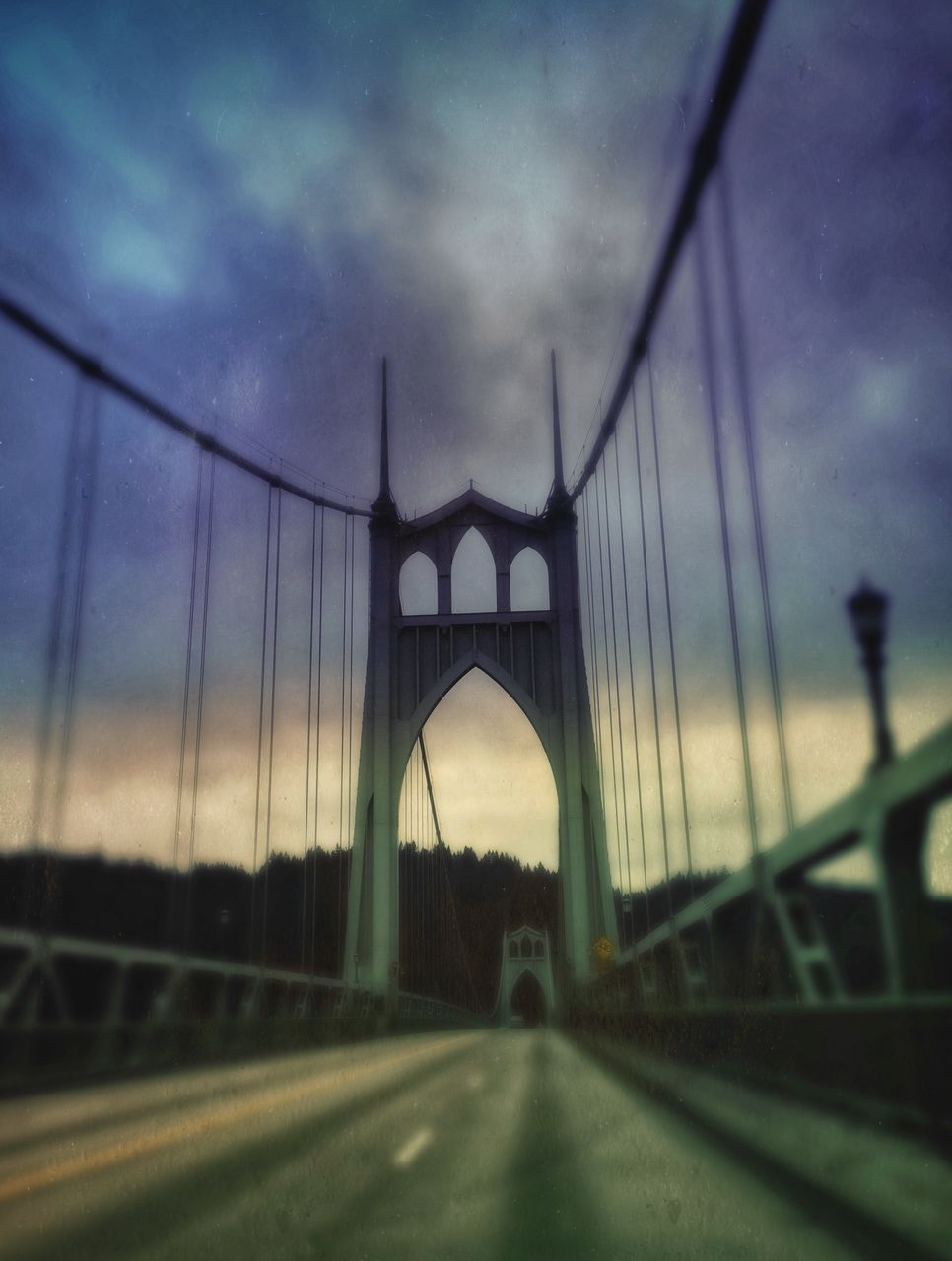 bridge - man made structure, connection, suspension bridge, engineering, transportation, architecture, sky, road, built structure, travel, bridge, travel destinations, outdoors, the way forward, cloud - sky, no people, day, chain bridge, city