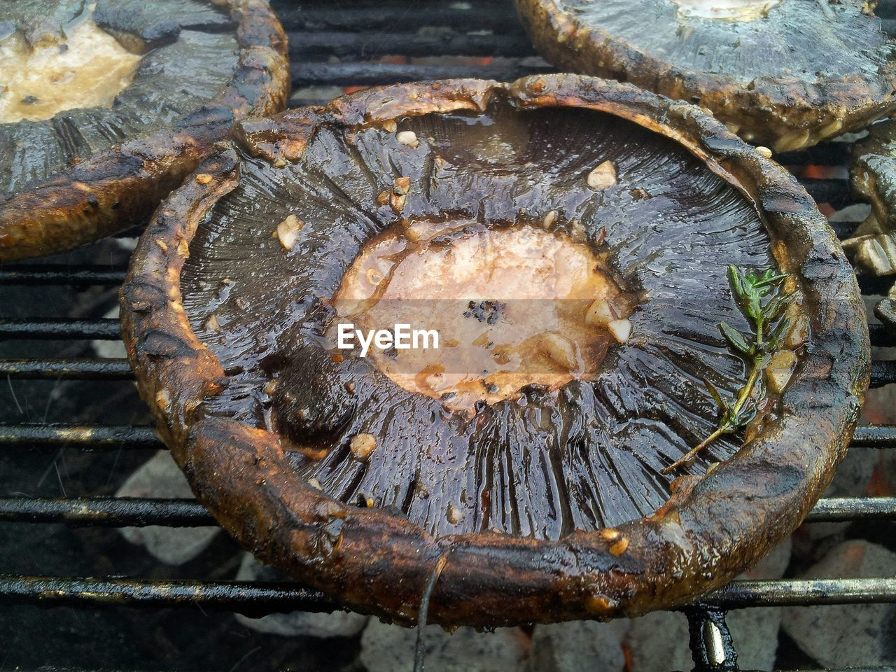 High Angle View Of Portobello Mushrooms On Barbeque Grill
