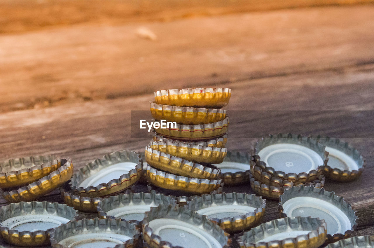 food and drink, still life, food, no people, large group of objects, table, close-up, high angle view, stack, focus on foreground, freshness, wellbeing, indoors, selective focus, business, day, wood - material, coin, variation, choice