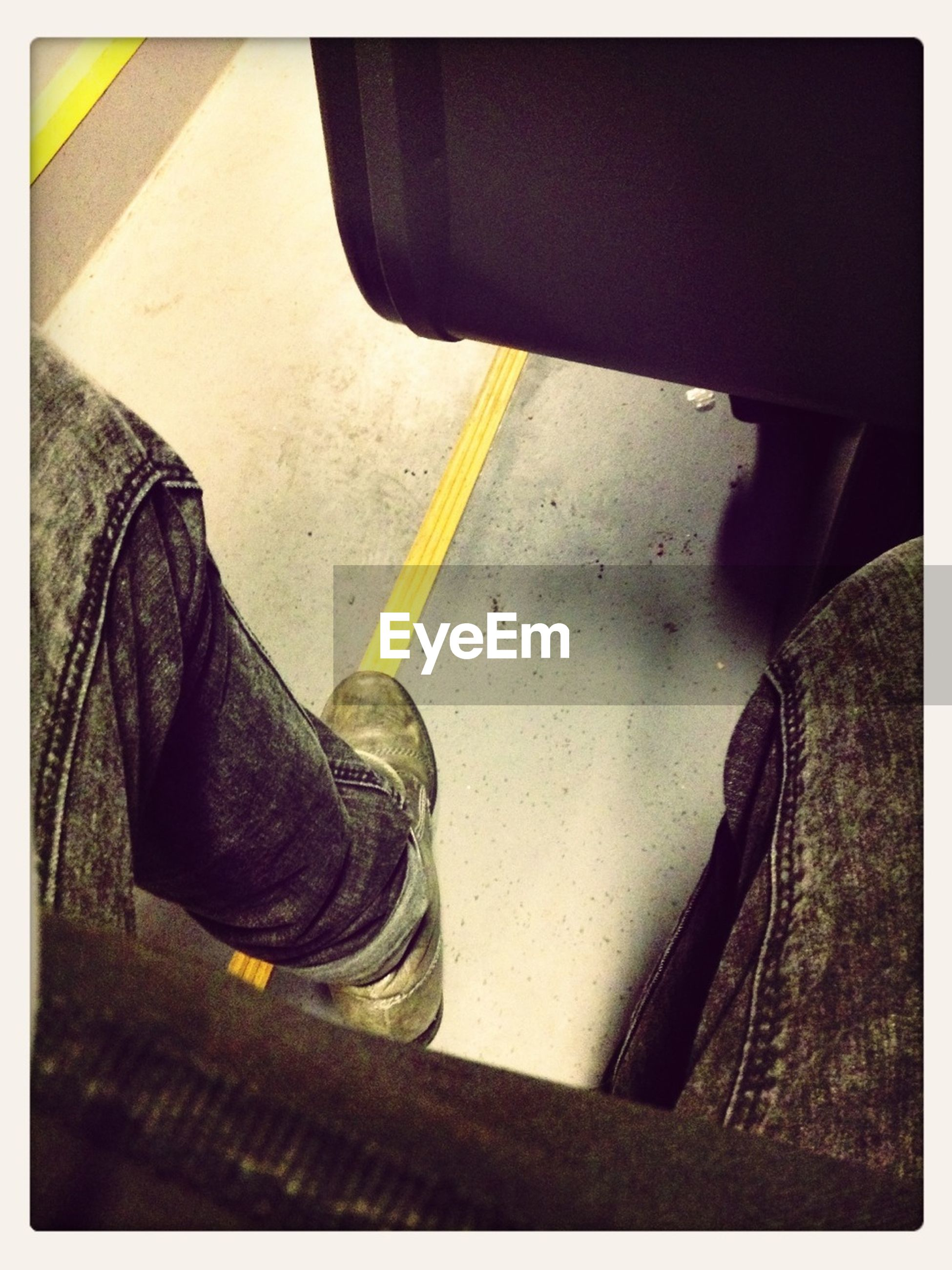 transfer print, auto post production filter, low section, person, shoe, high angle view, indoors, footwear, one person, close-up, jeans, human foot, metal, sunlight, part of, day, standing, shadow, street