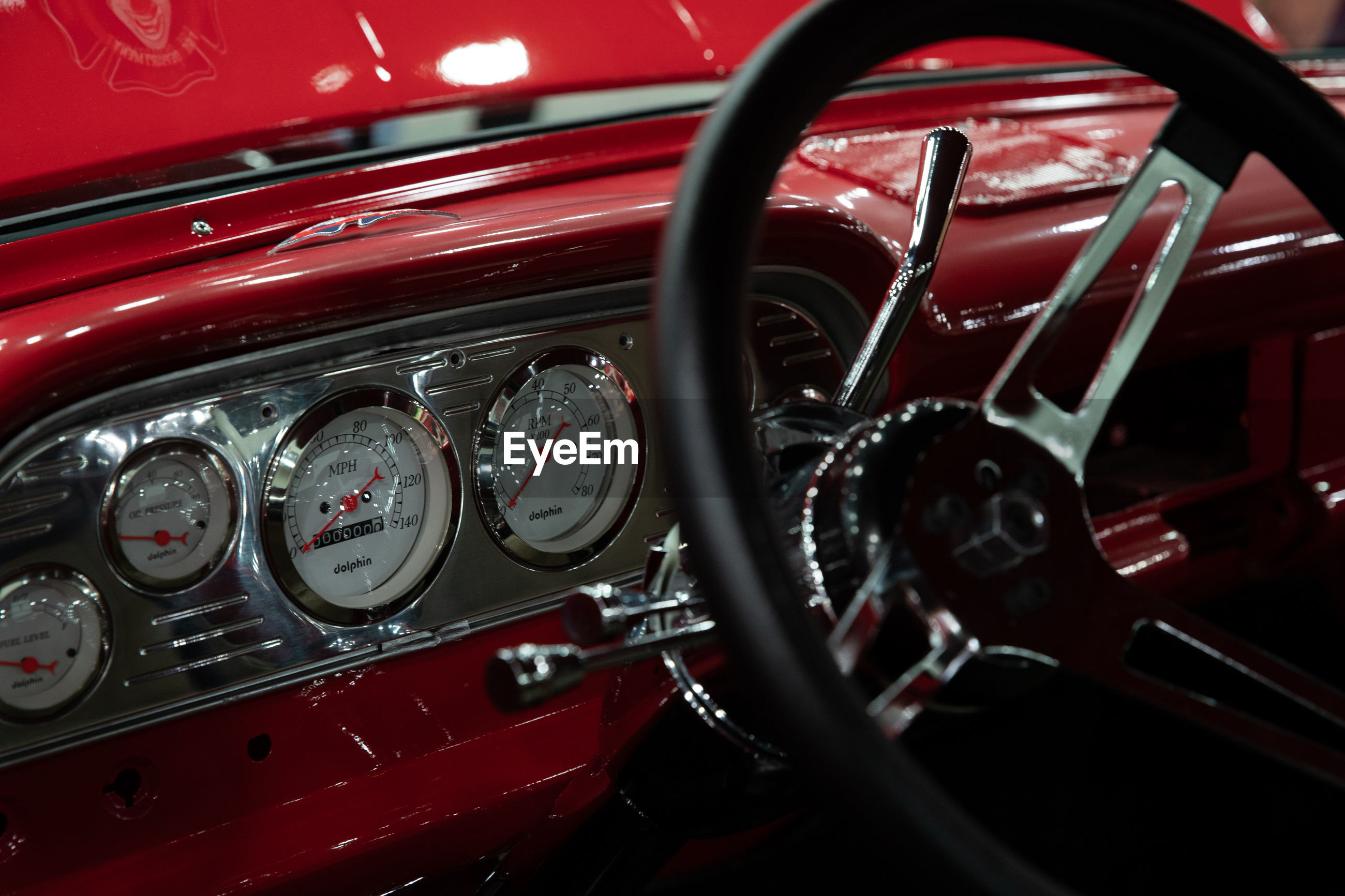 CLOSE-UP OF VINTAGE CAR WITH CAMERA IN BACKGROUND