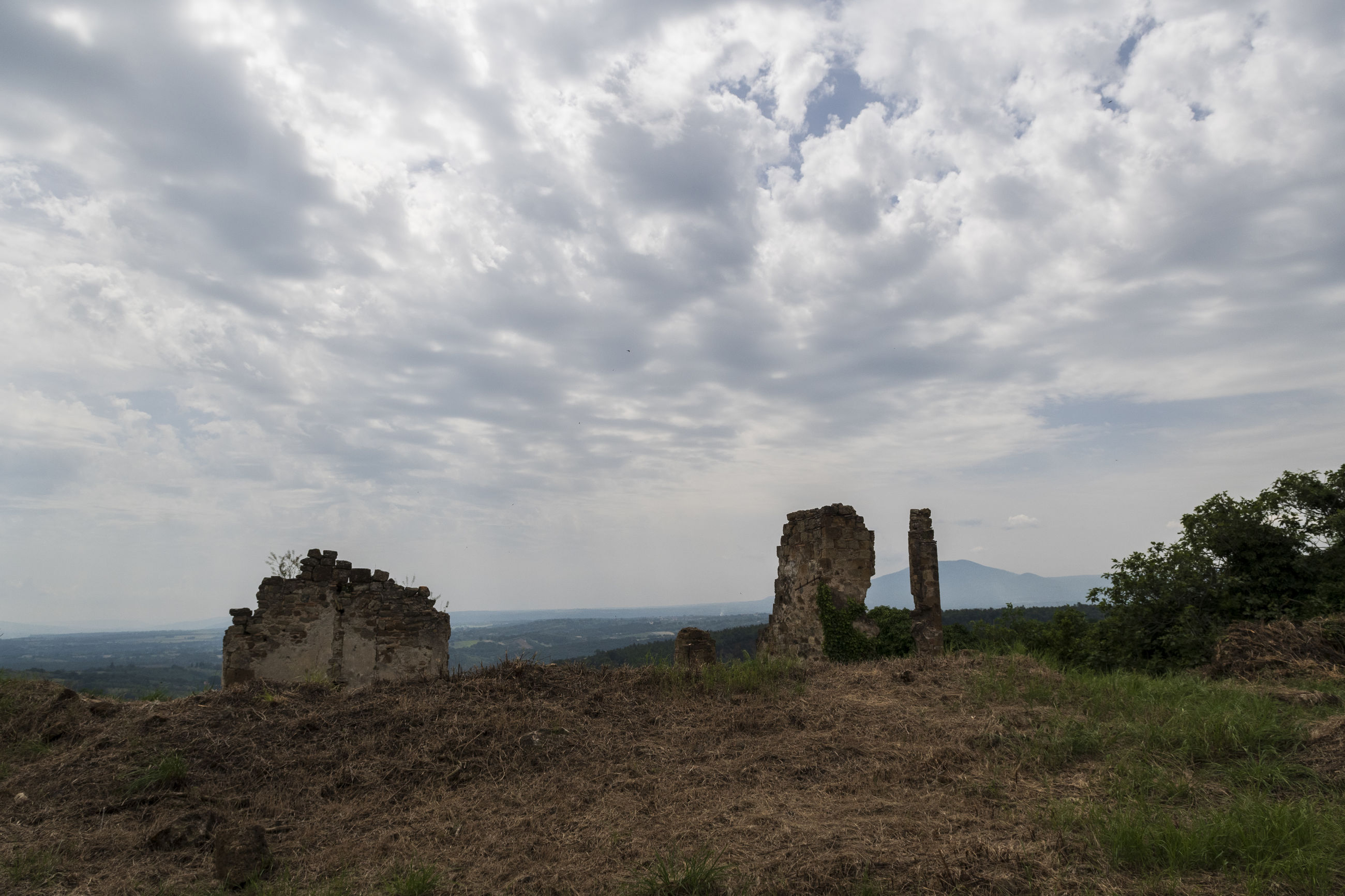 Old ruin building on landscape against sky