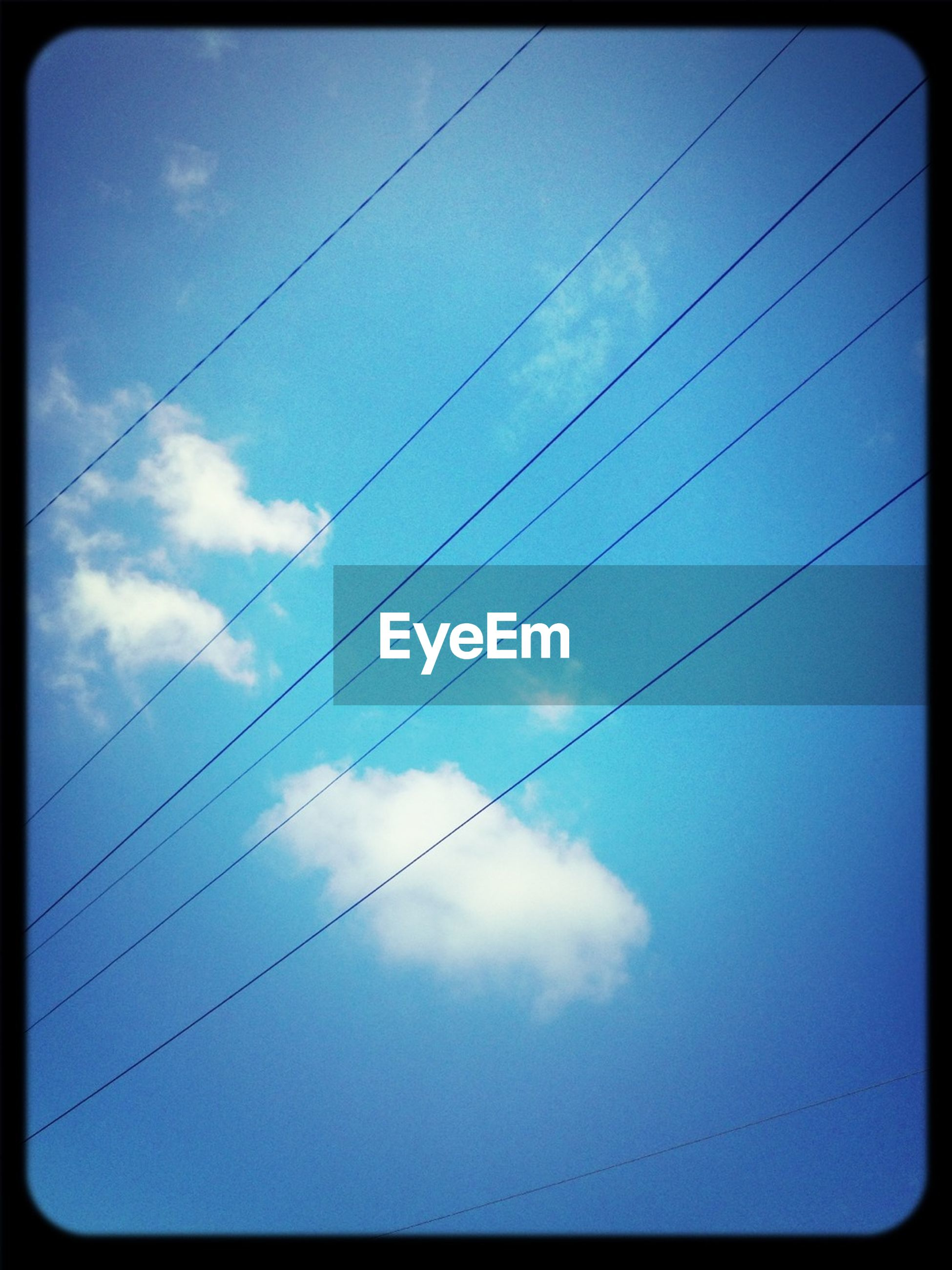 power line, low angle view, cable, electricity, power supply, electricity pylon, connection, sky, transfer print, power cable, cloud - sky, auto post production filter, fuel and power generation, technology, cloud, silhouette, cloudy, blue, no people, outdoors