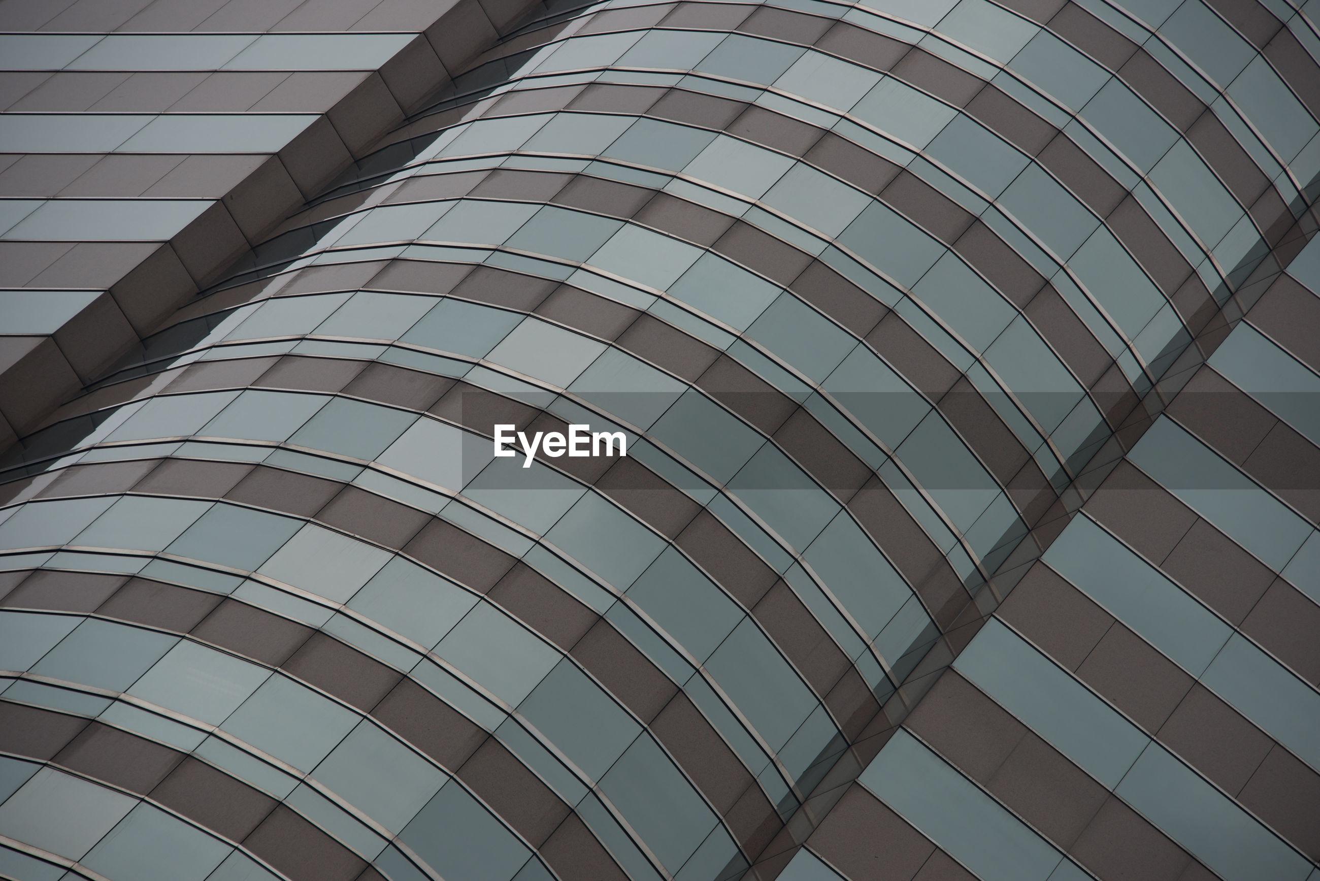 Full frame shot of modern glass building in city