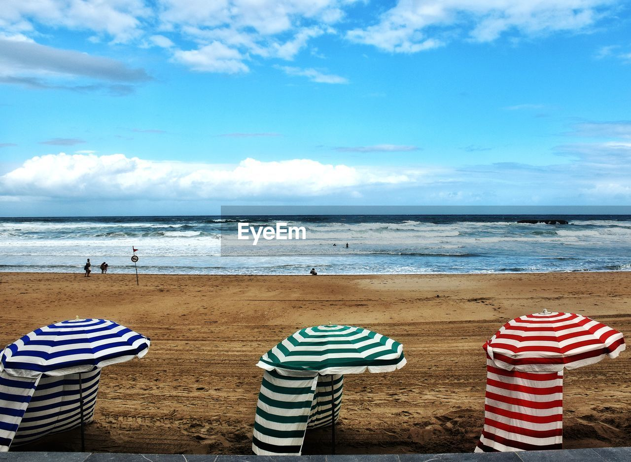 sky, land, striped, beach, water, sea, cloud - sky, horizon, horizon over water, nature, day, beauty in nature, tranquility, tranquil scene, sand, scenics - nature, blue, outdoors, non-urban scene