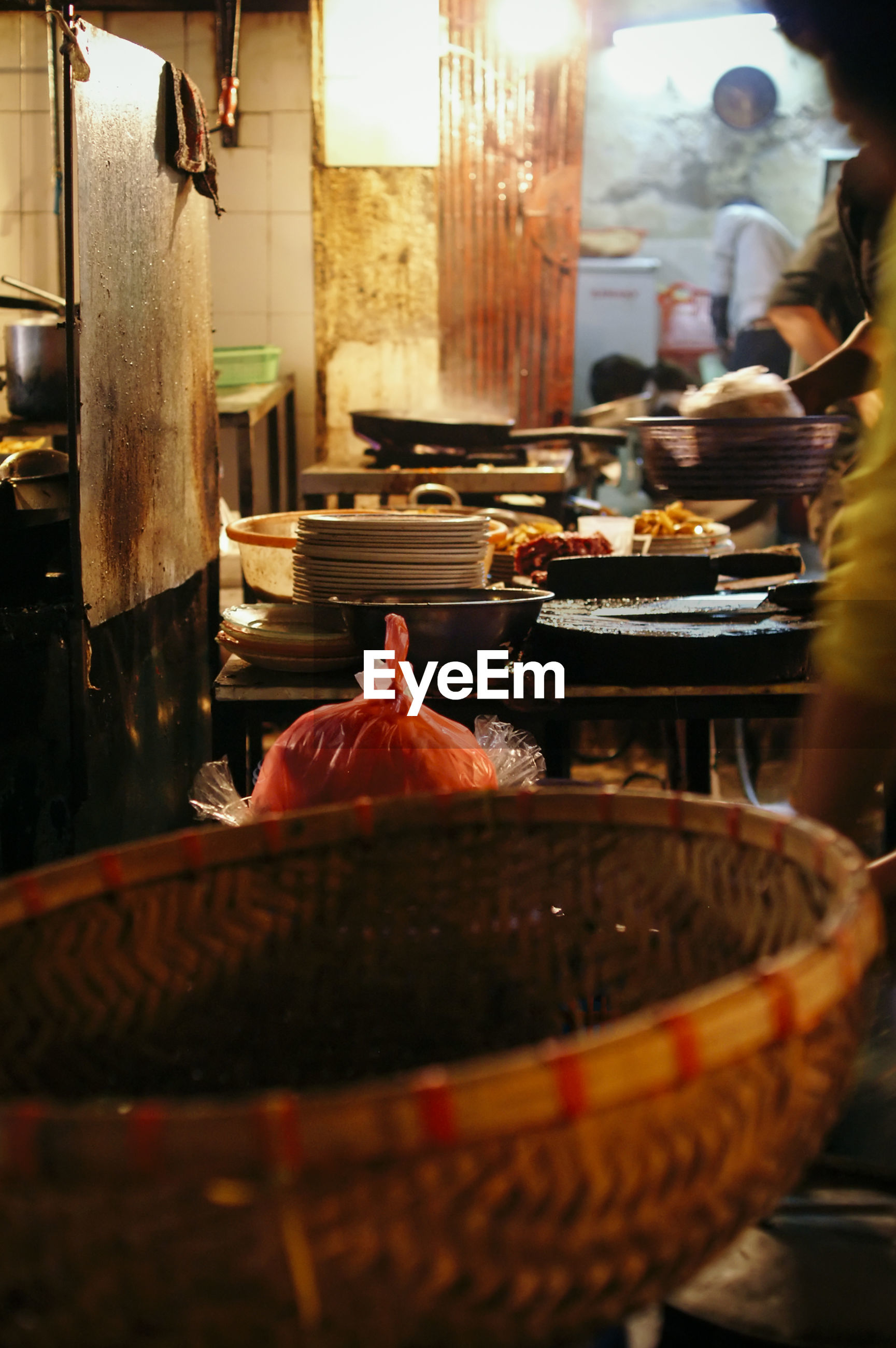 Close-up of basket with food in background