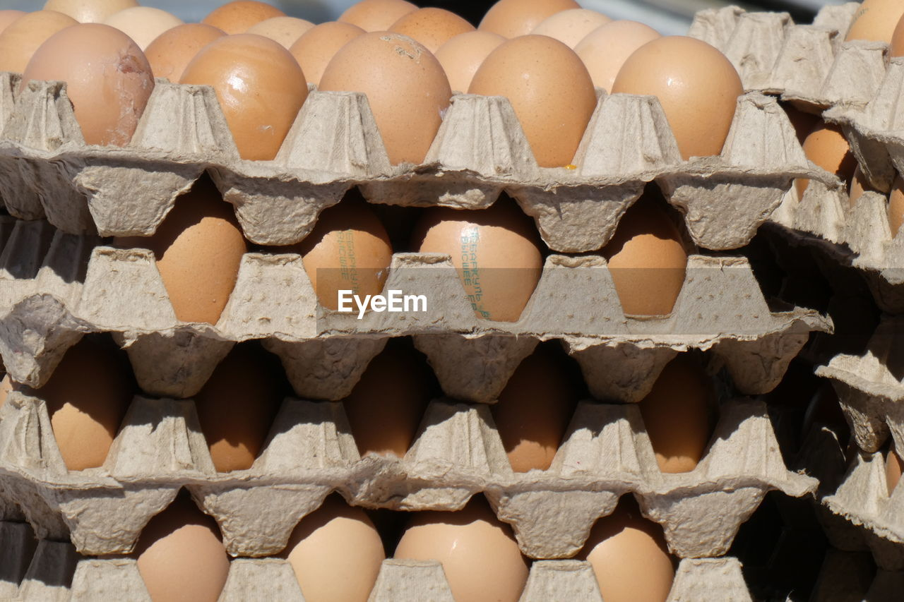 large group of objects, egg carton, food and drink, egg, food, wellbeing, healthy eating, abundance, full frame, arrangement, no people, in a row, freshness, order, backgrounds, still life, brown, repetition, market, close-up, carton