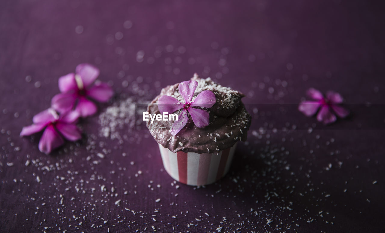 freshness, flower, flowering plant, close-up, plant, sweet food, pink color, beauty in nature, no people, purple, indulgence, petal, focus on foreground, nature, table, indoors, sweet, food and drink, food, dessert, temptation, flower head
