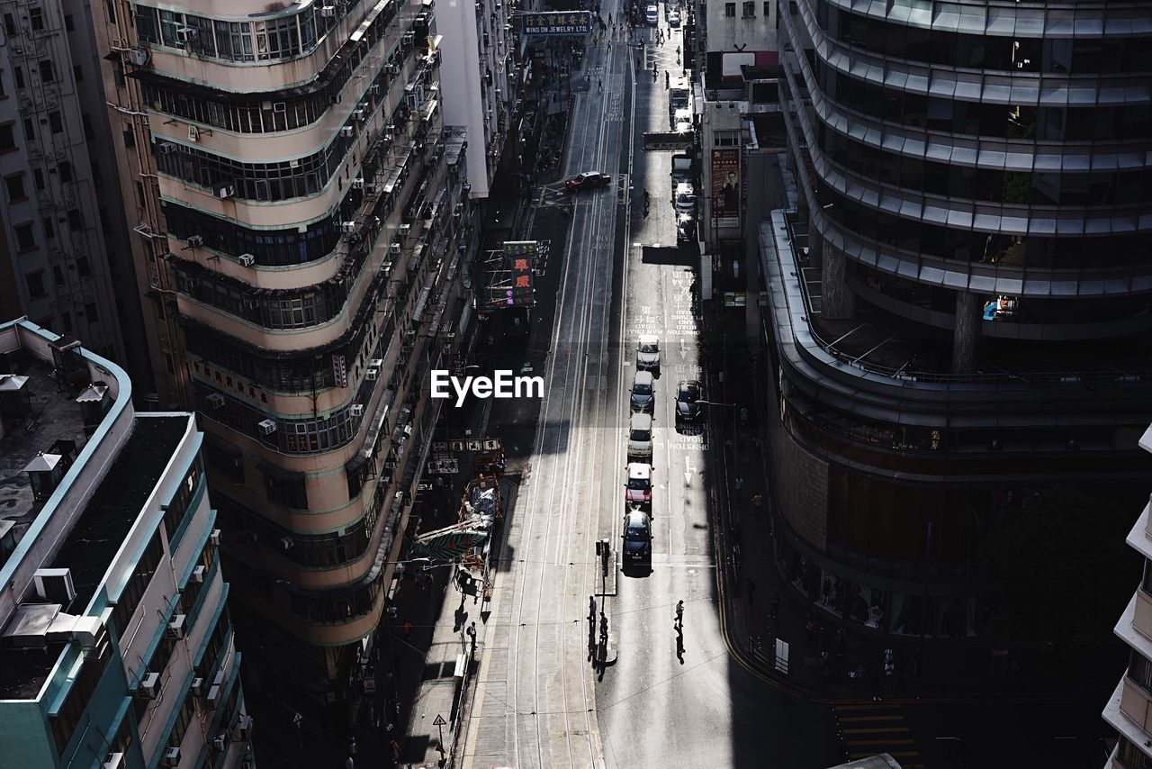 High angle view of city street by modern buildings