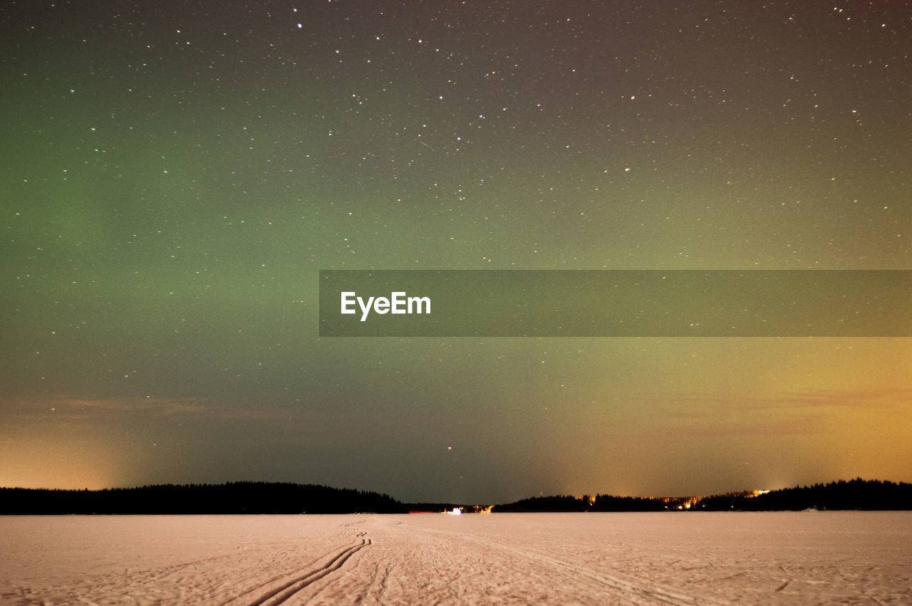 sky, scenics - nature, beauty in nature, night, tranquil scene, tranquility, environment, star - space, landscape, no people, space, astronomy, nature, non-urban scene, land, idyllic, snow, winter, cold temperature, field