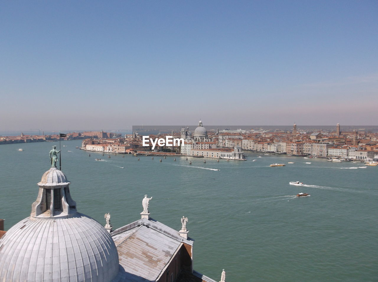 Church Of San Giorgio Maggiore By Grand Canal And Old Town Against Sky