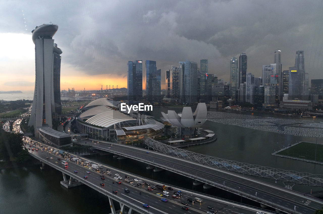 Singapore Cityscape Against Cloudy Sky