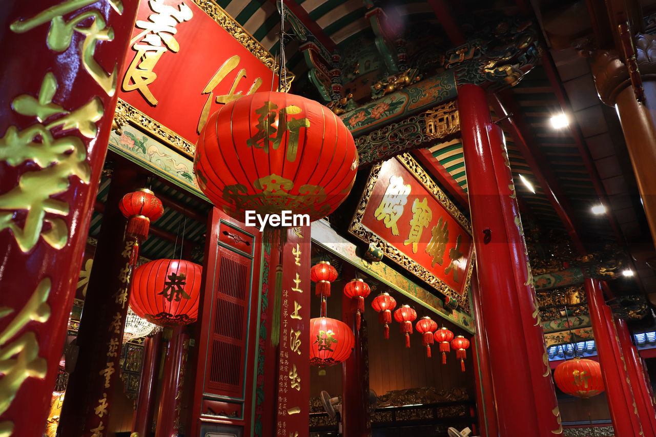 lighting equipment, lantern, architecture, built structure, text, hanging, script, non-western script, chinese lantern, red, illuminated, low angle view, communication, decoration, building exterior, no people, building, chinese new year, chinese lantern festival, festival, paper lantern
