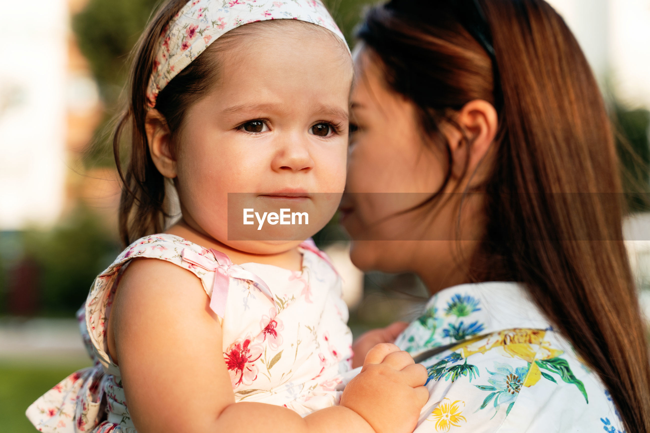 PORTRAIT OF CUTE BABY GIRL WITH MOTHER