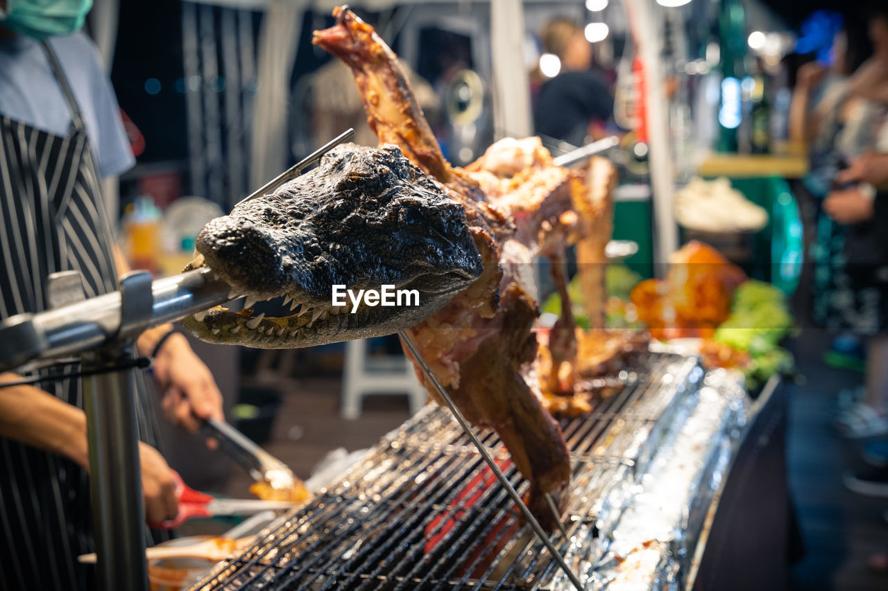food, food and drink, meat, freshness, incidental people, market, barbecue, for sale, animal, focus on foreground, fish, heat - temperature, healthy eating, wellbeing, vertebrate, selective focus, burning, grilled, outdoors, day, preparing food, street food