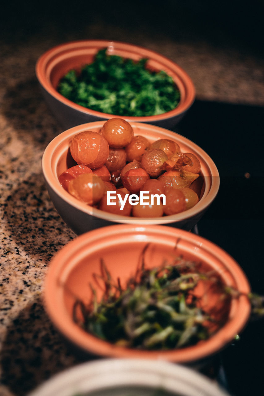 High angle view of vegetables in bowls on floor