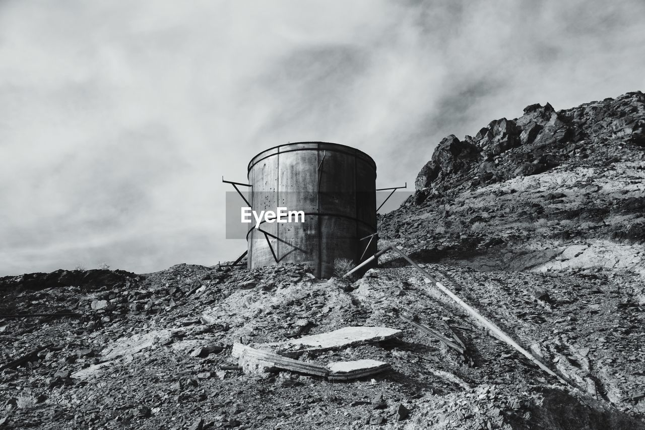 sky, nature, day, mountain, no people, cloud - sky, rock, rock - object, outdoors, storage tank, solid, industry, architecture, built structure, non-urban scene, environment, mountain range, land, rock formation