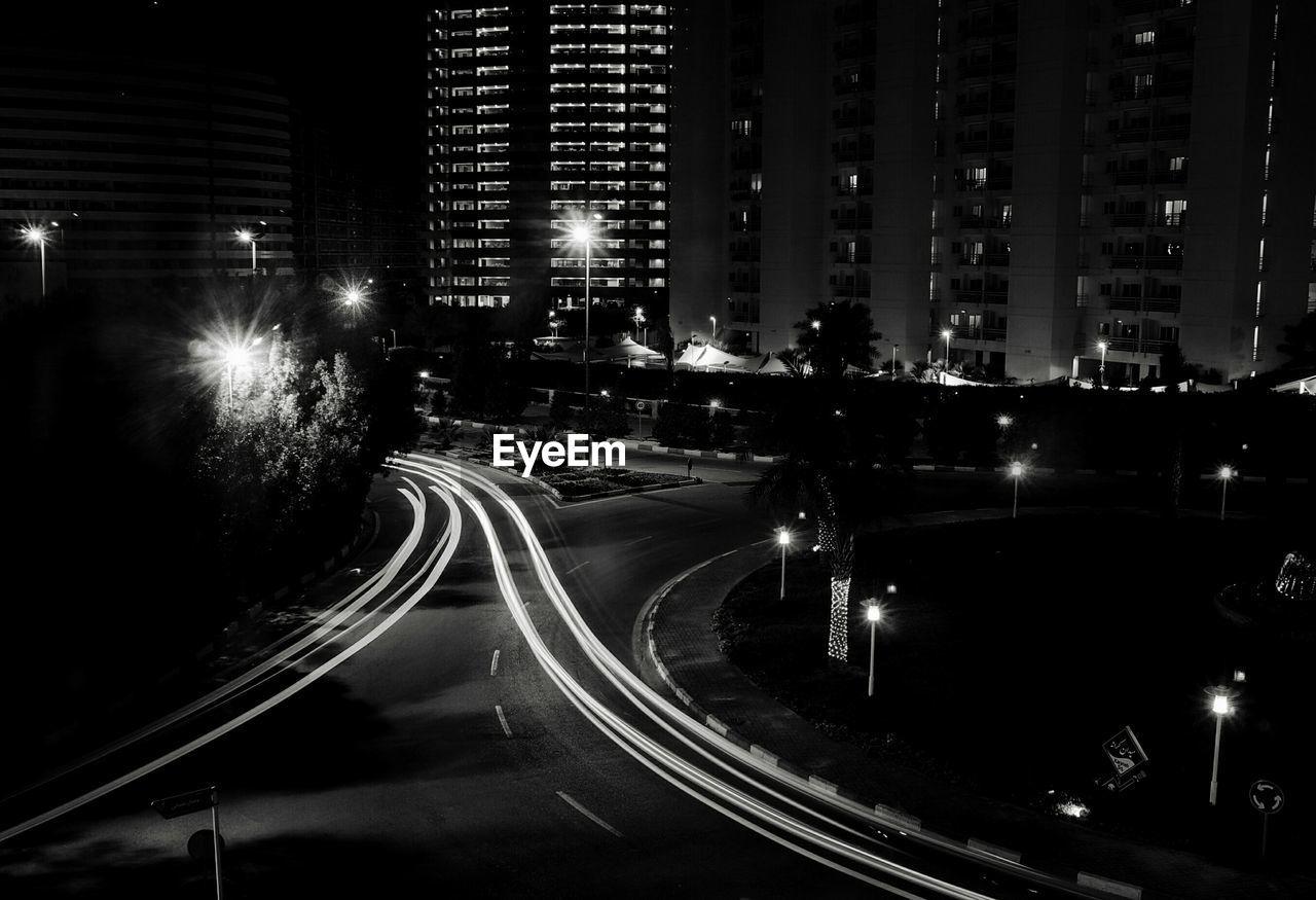illuminated, night, speed, light trail, motion, transportation, street light, building exterior, architecture, high street, long exposure, city, road, outdoors, urban scene, no people