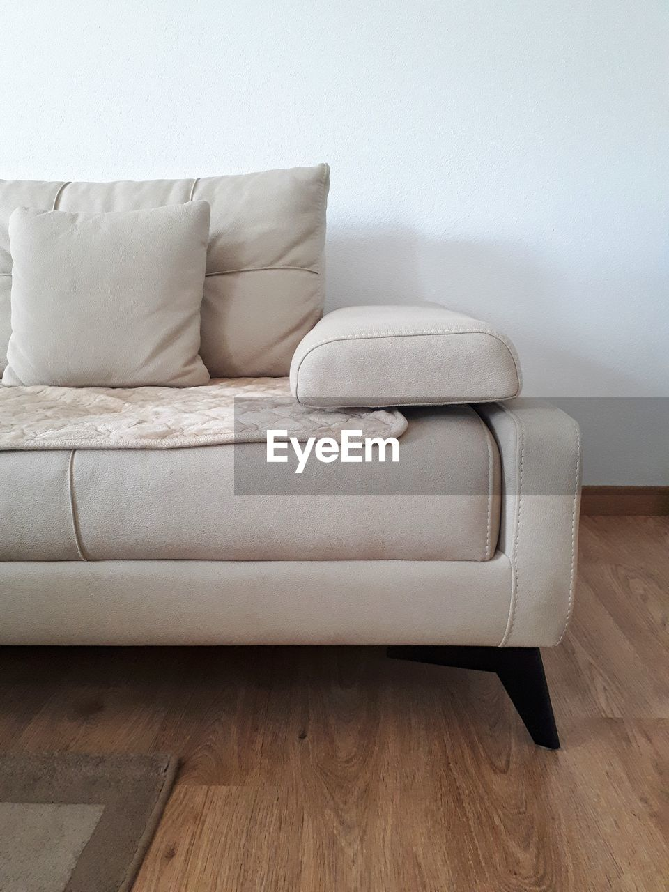 CLOSE-UP OF SOFA IN HOME