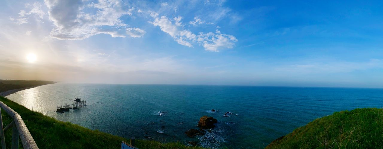 water, sea, sky, horizon over water, scenics - nature, horizon, cloud - sky, beauty in nature, tranquil scene, tranquility, blue, nature, panoramic, idyllic, day, beach, non-urban scene, land, high angle view, outdoors, no people