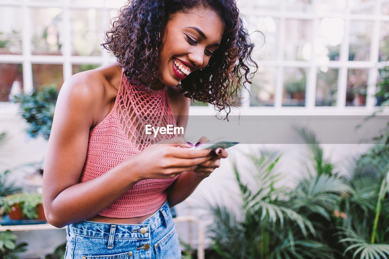 Close-Up Of Young Woman Using Mobile Phone