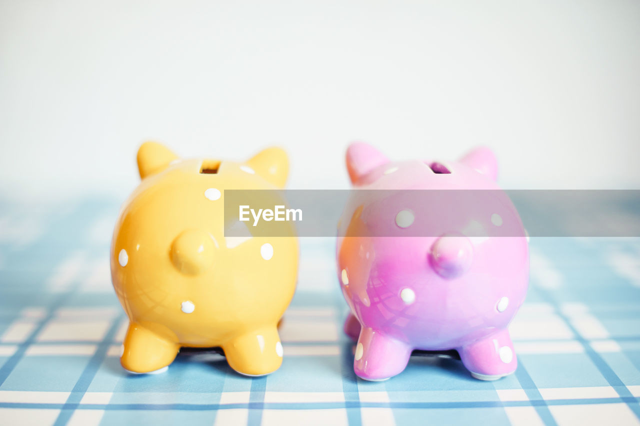 finance, savings, investment, piggy bank, animal representation, representation, business, pink color, indoors, no people, wealth, currency, close-up, still life, toy, focus on foreground, studio shot, coin bank, coin