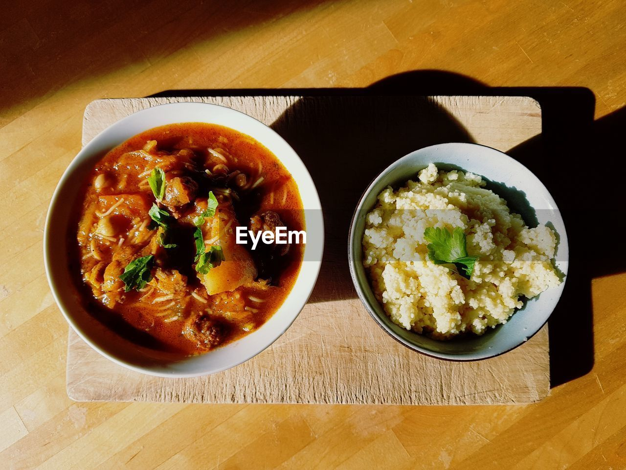 table, food and drink, food, ready-to-eat, freshness, indoors, healthy eating, bowl, serving size, still life, high angle view, no people, rice - food staple, plate, wood - material, rice, meal, close-up, day
