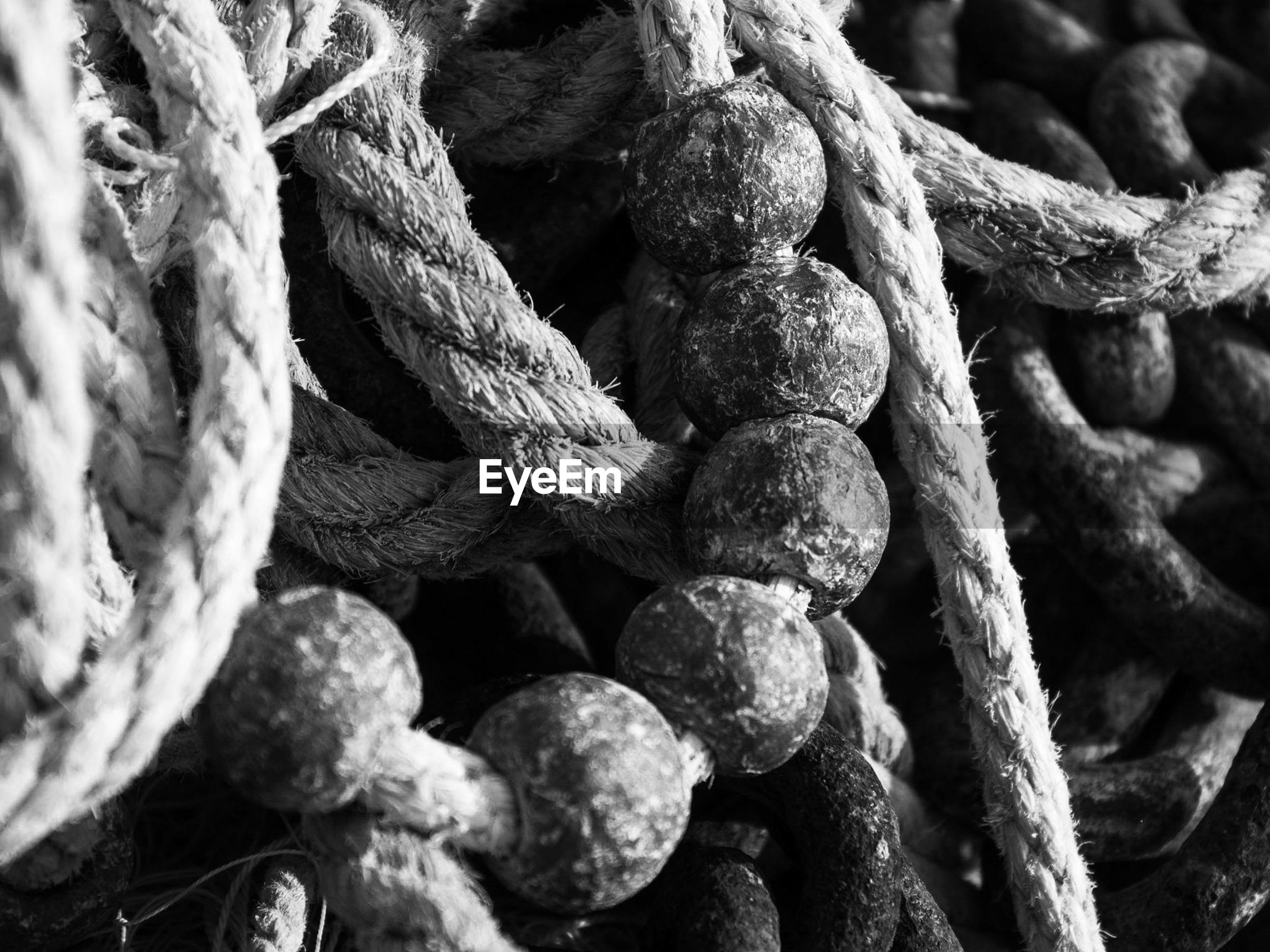 FULL FRAME SHOT OF ROPE TIED UP OF METAL