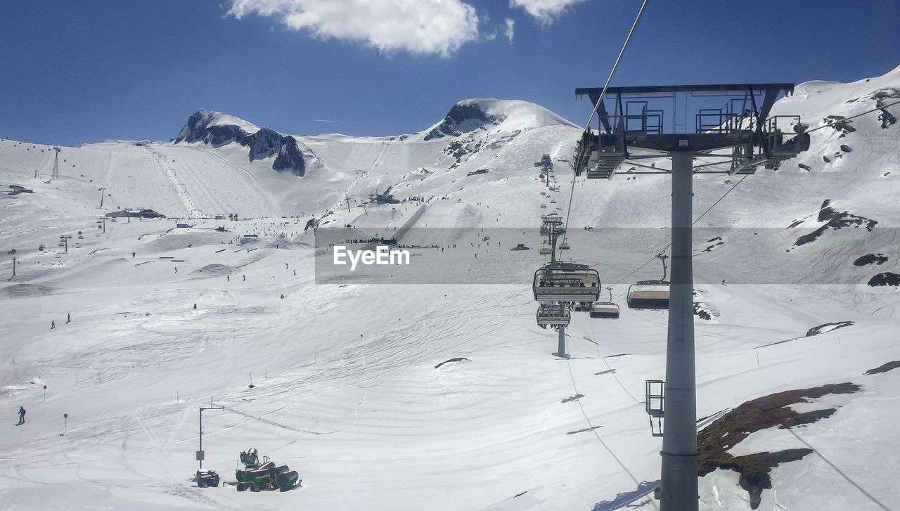 winter, cold temperature, snow, mountain, cable car, scenics - nature, ski lift, beauty in nature, sky, overhead cable car, day, covering, white color, nature, mountain range, snowcapped mountain, landscape, cable, environment, outdoors, ski resort