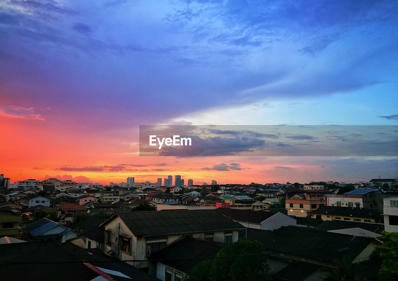 building exterior, built structure, architecture, cloud - sky, sky, sunset, building, city, residential district, cityscape, nature, no people, high angle view, orange color, house, outdoors, roof, community, townscape, romantic sky, settlement