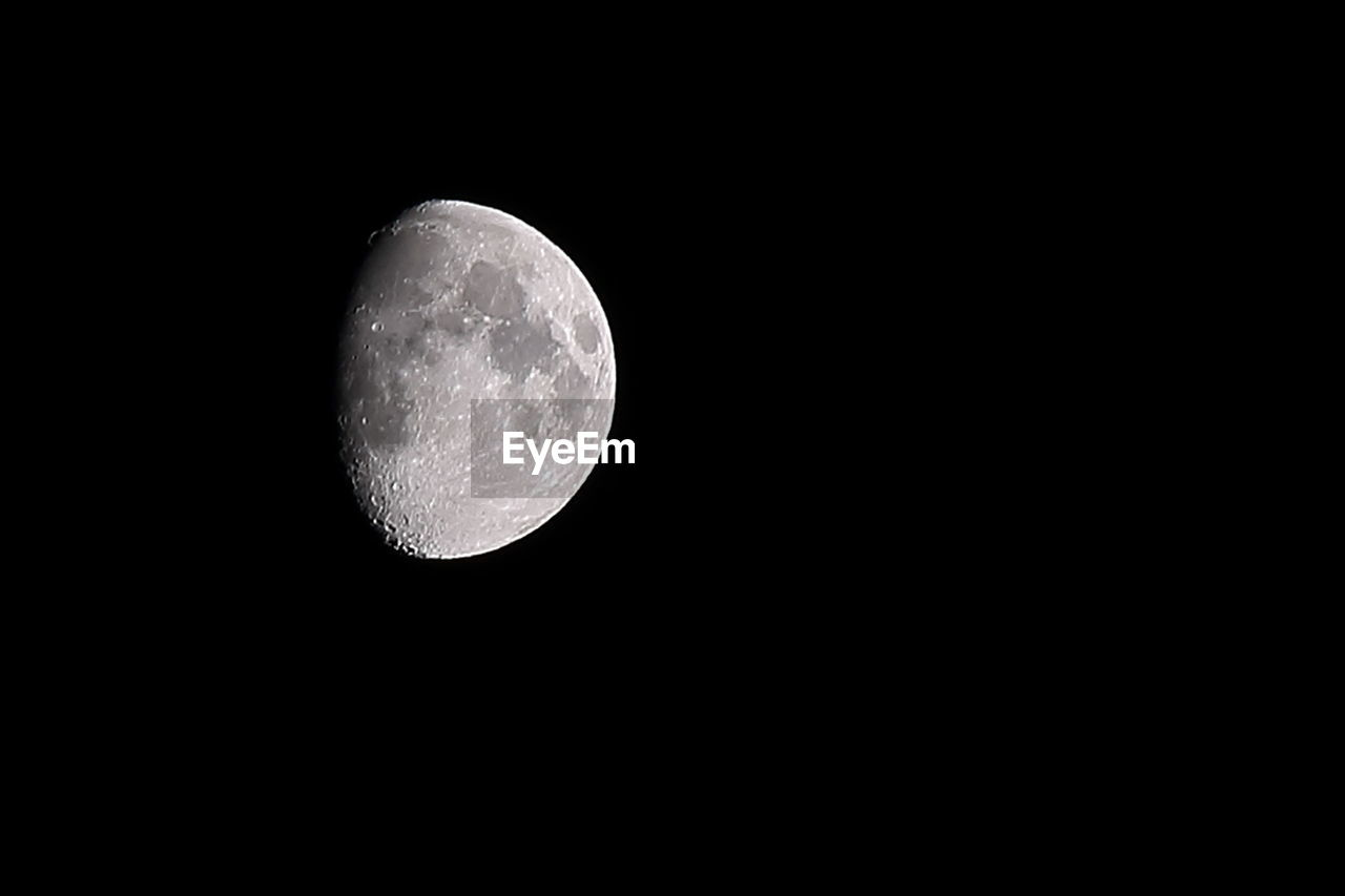 moon, night, moon surface, astronomy, full moon, planetary moon, beauty in nature, low angle view, nature, scenics, idyllic, tranquility, space exploration, tranquil scene, no people, outdoors, clear sky, discovery, moonlight, half moon, space, sky, close-up
