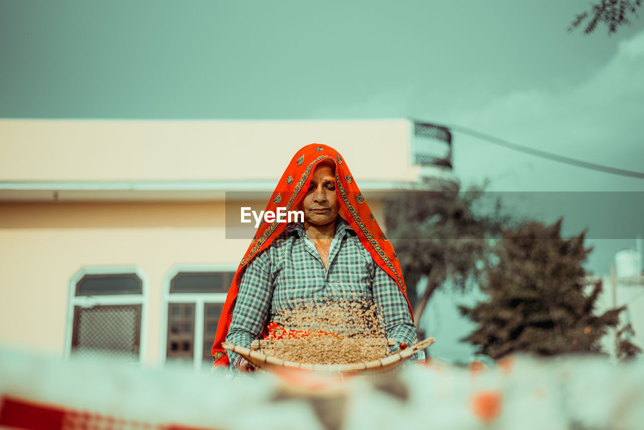 Portrait of an  indian rural woman doing daily chores